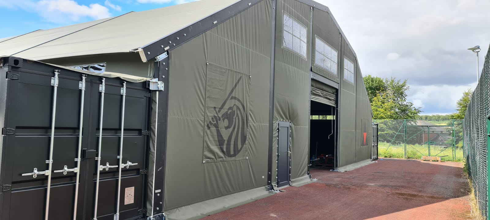 Container Building for British Army with aluminium structure to support fabric roof
